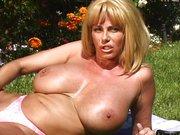 Busty MILF Penny Porsche masturbating outdoors